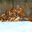 Stock Photo: Woodpile on snow