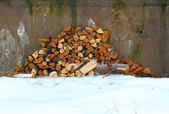 Woodpile on the snow — Stock Photo