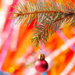 Christmas tree and red glass ball — Stock Photo