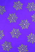Purple background with snowflakes — Stock Photo