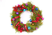 Green christmas wreath with decorations — Stock Photo