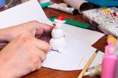 Handicraft snowman figurine — Stock Photo