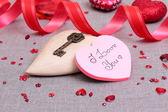 Valentinstagskarte mit holz herz — Stockfoto