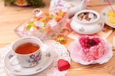 Warm cup of tea and sweets — Foto de Stock