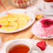 Stock Photo: Warm cup of teand sweets