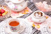 Warm cup of tea and sweets — Stock Photo
