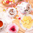Warm cup of tea and sweets — Stock Photo #39132725