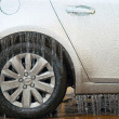 Stock Photo: Car side covered with ice