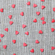 Linen canvas with little red hearts — Stockfoto #39409381