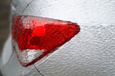 Car rear light covered with ice — Stock Photo