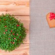 Heart shaped gingerbread cookie over linen cloth — Stockfoto #39471963