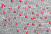 Linen canvas with little red hearts — Stock Photo