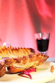 Delicious smoked ribs and glass of wine — Stock Photo