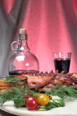 Delicious smoked ribs and wine — Stock Photo