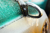 Car side mirror covered with ice — Stock Photo