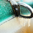 Stock Photo: Car side mirror covered with ice