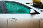 Car side covered with ice — Stock Photo