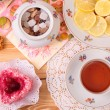 Warm cup of teand sweets — Stock Photo #39829823