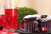 Chocolate muffins and glass of berry drink — Stock Photo