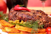 Appetizing roasted fillet of pork — Stock Photo