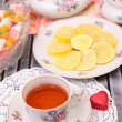 Warm cup of teand sweets — Stock Photo #40647645