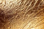 Texture of golden metallizic fabric — Stock Photo