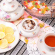 Warm cup of teand sweets — Stock Photo #41020067