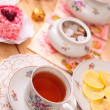 Warm cup of teand sweets — Stock Photo #41020097