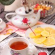 Warm cup of teand sweets — Stockfoto #41160423