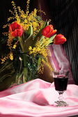 Still life with flowers and red wine — Stock Photo
