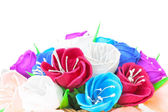 Beautiful paper flowers in basket — Stock Photo