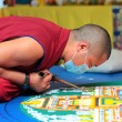 Tibetian monks constructing mandala from colored sand — Stock Photo #50491505