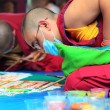 Tibetian monks constructing mandala from colored sand — Stock Photo #50492201