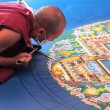 Tibetian monks constructing mandala from colored sand — Stock Photo #50493805