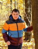 Man on the background of autumn — Stock Photo
