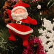 Christmas Toy Santa Claus on the Christmas tree — Stockfoto