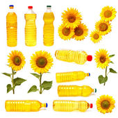 Sunflowers and bottles of sunflower oil — Stock Photo