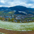 First winter snow in Carpathian mountain and village. — Stock Photo