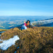 Family walk on autumn mountain plateau with first winter snow — Stock Photo