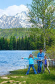 Strbske Pleso (Slovakia) spring view and family — Stock fotografie