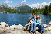Strbske Pleso (Slovakia) spring view and family — Stock Photo