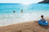 Family on summer Ionian sea — Stock Photo