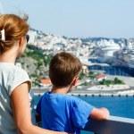 Family on bridge looking at port (Dubrovnik , Croatia) — Stock Photo #16311249