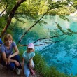 Stock Photo: Family near summer azure limpid transparent lake (Plitvice, Cr