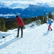 Family plays at snowballs on winter mountain slope — Stock fotografie