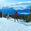 Family plays at snowballs on winter mountain slope — Stock Photo