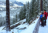 Alps waterfall winter view and family — Stock Photo