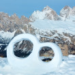 Wedding ring from the snow on mountainside. — Stock Photo #20830695