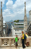 The roof of Milan Cathedra (Italy) and family. — Stock Photo
