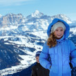 Children on winter  mountain background. Gardena Pass, Italy. - Stock Photo